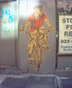 Guy on Bike near Baltazar or however you spell that place
